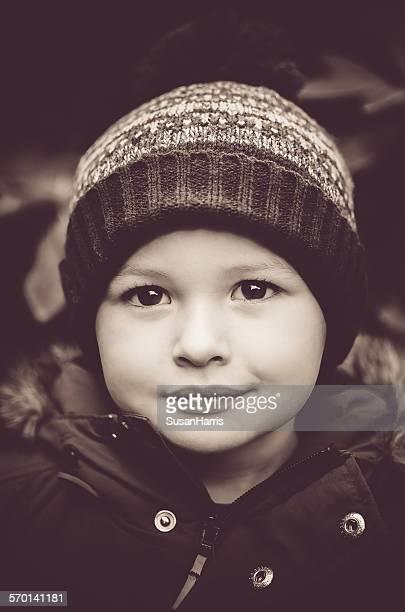 Portrait of a boy wearing a bobble hat