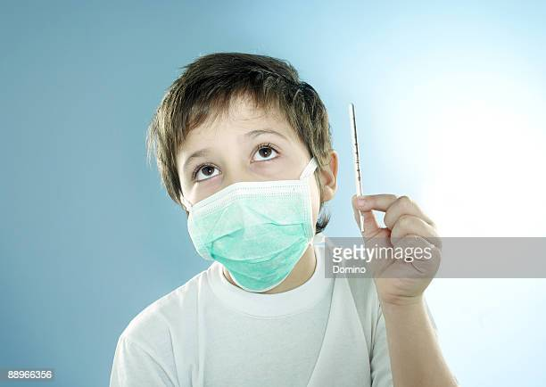 Portrait of a boy wearing a surgical mask