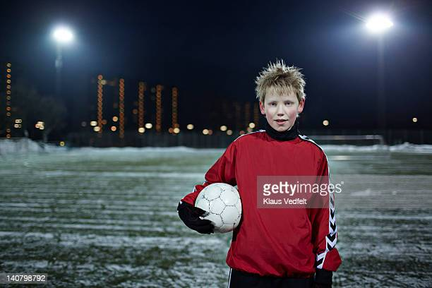 portrait of a boy with a football (soccer)