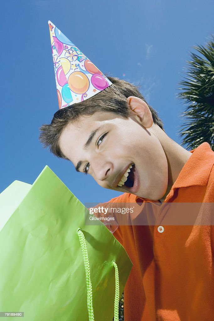 Portrait of a boy with a gift bag : Stock Photo