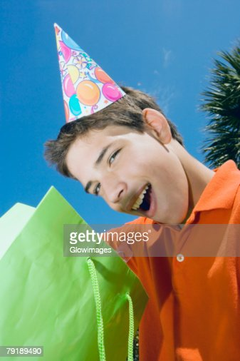 Portrait of a boy with a gift bag : Foto de stock