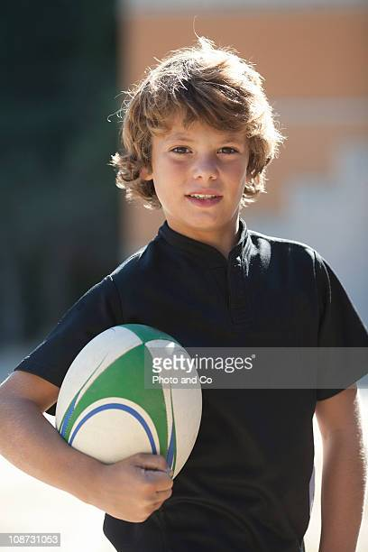 Portrait of a boy with rugby ball