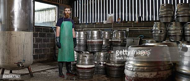 Portrait of a brewery worker in his working environment