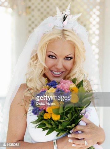 Portrait of a Bride Holding a Bouquet of Flowers