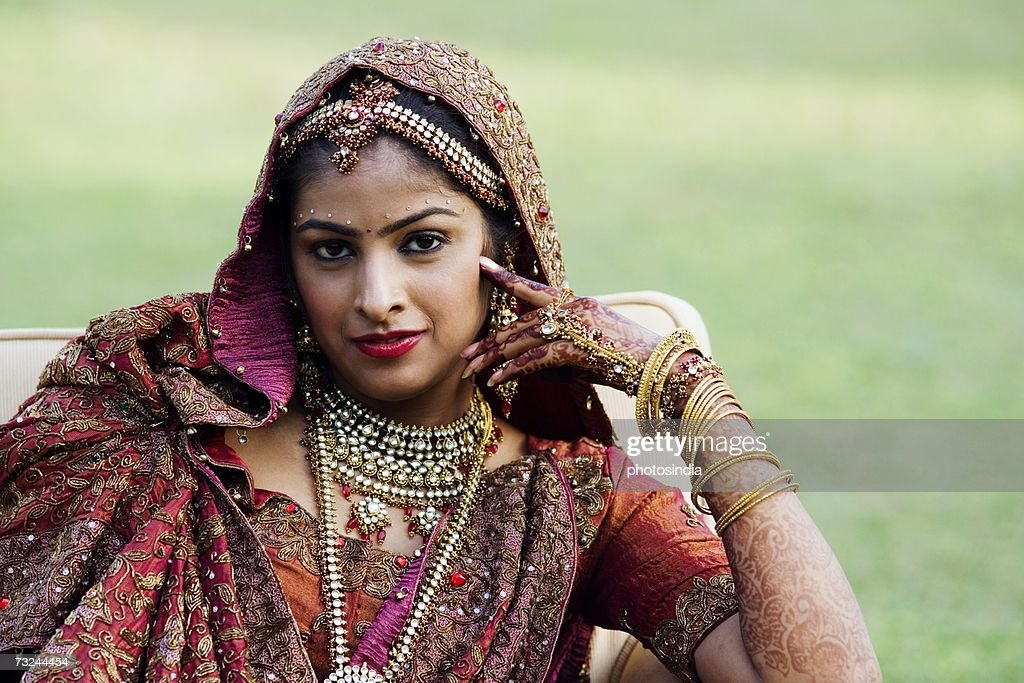 Portrait of a bride in a traditional wedding dress : Stock Photo