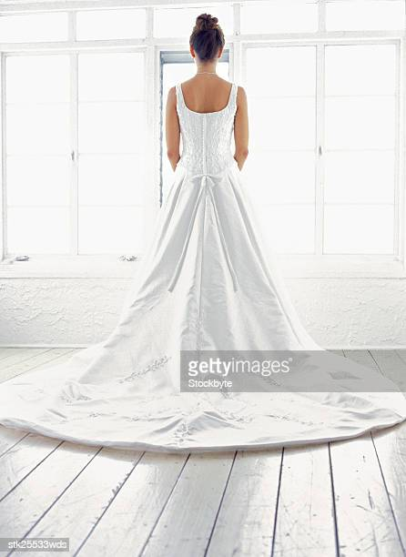 portrait of a bride standing by the window