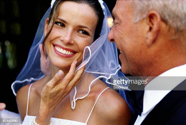 portrait of a bride standing with her father
