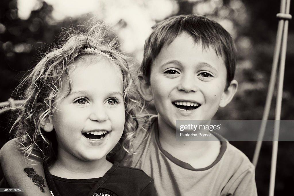 portrait of a brother and sister that look happy : Stock Photo