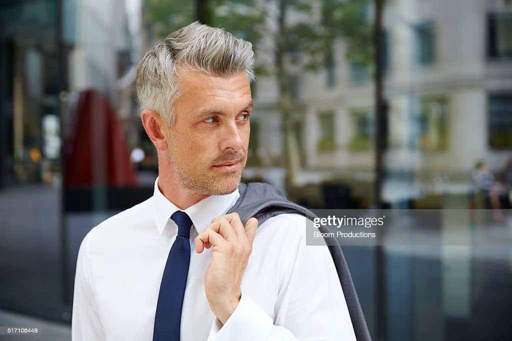 Portrait of a business man looking behind