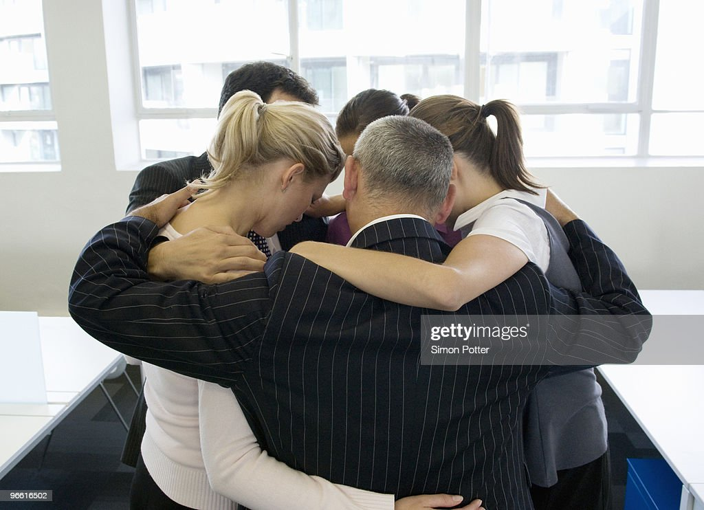 A portrait of a business team huddling : Stock Photo