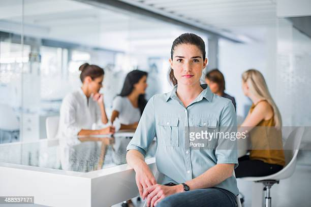 Portrait of a business woman sitting at desk