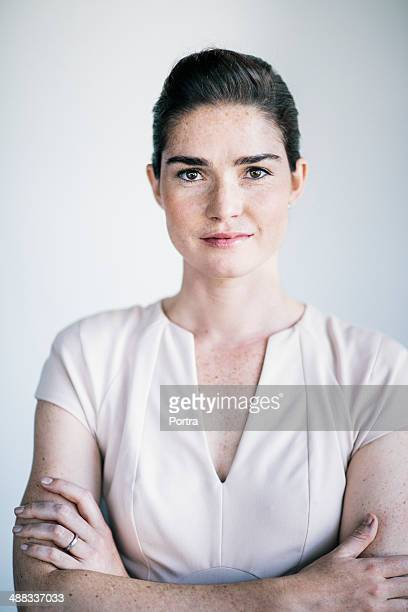 Portrait of a business woman with arms crossed.