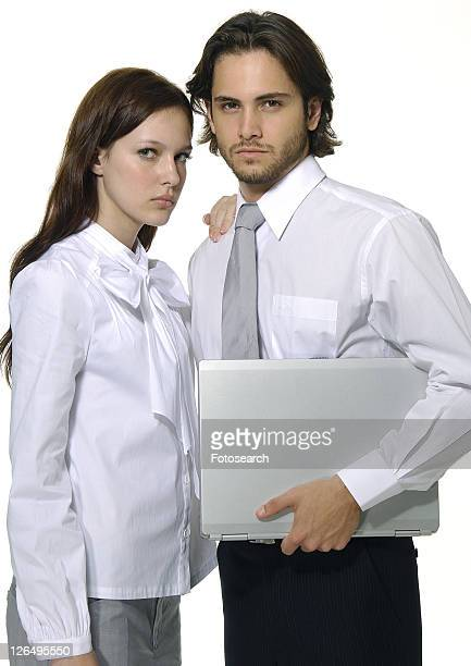 Portrait of a businessman and a businesswoman standing together