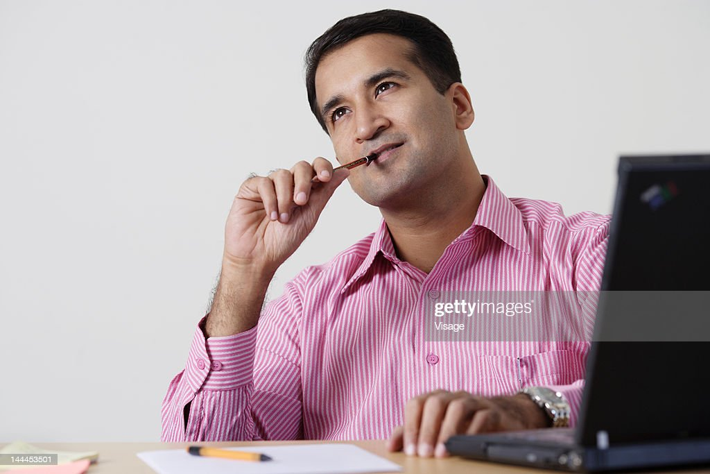Portrait of a businessman at work, working : Stock Photo