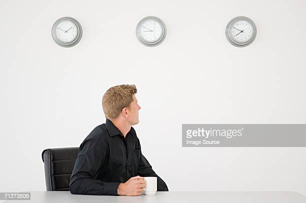 Portrait of a businessman checking time