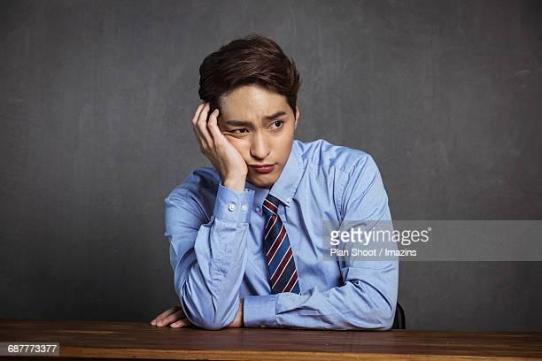 Portrait of a Businessman feeling Blue