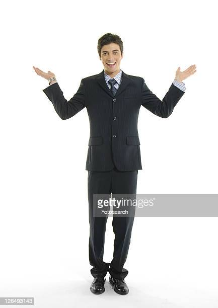 Portrait of a businessman gesturing and smiling