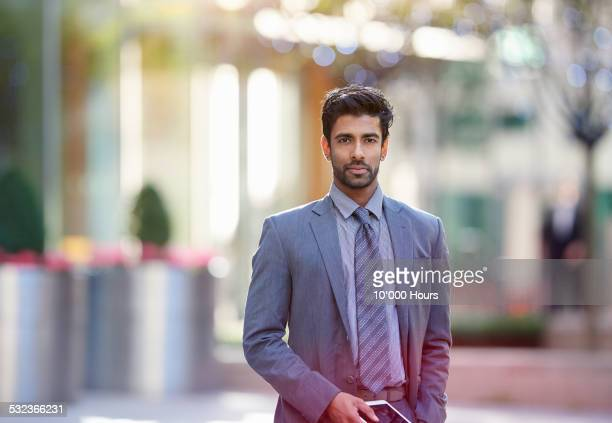 Portrait of a businessman holding a digital table