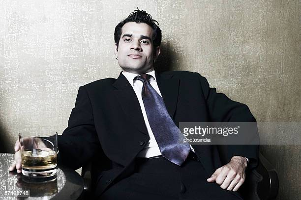Portrait of a businessman holding a glass of whiskey