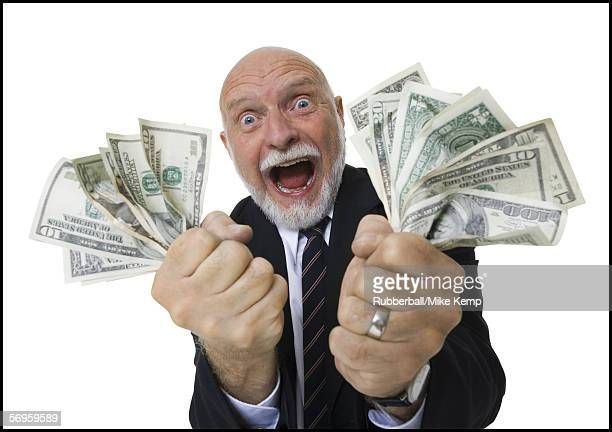 Portrait of a businessman holding American dollar bills