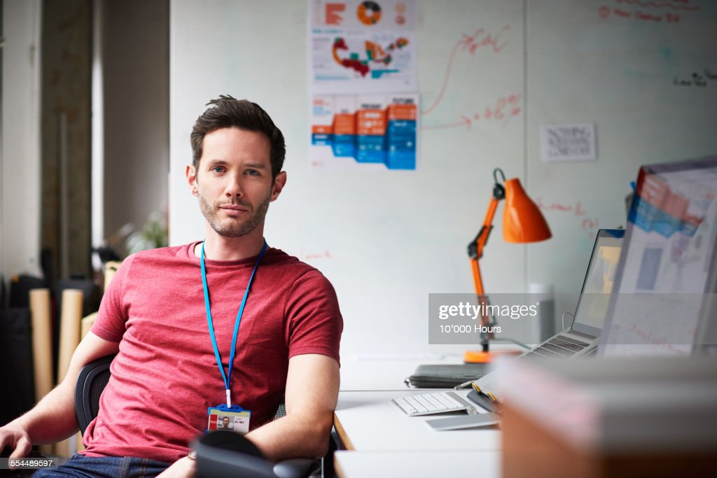 Portrait of a businessman in tech start-up office