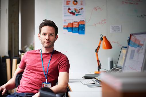 Portrait of a businessman in tech start-up office