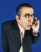 Portrait of a Businessman Listening to his Mobile Phone