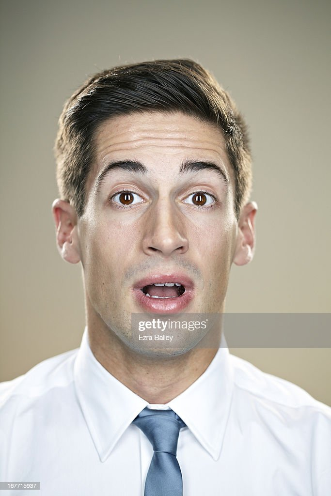 Portrait of a businessman looking shocked. : Stock Photo