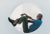 Portrait of a Businessman Lying in a Circular Window