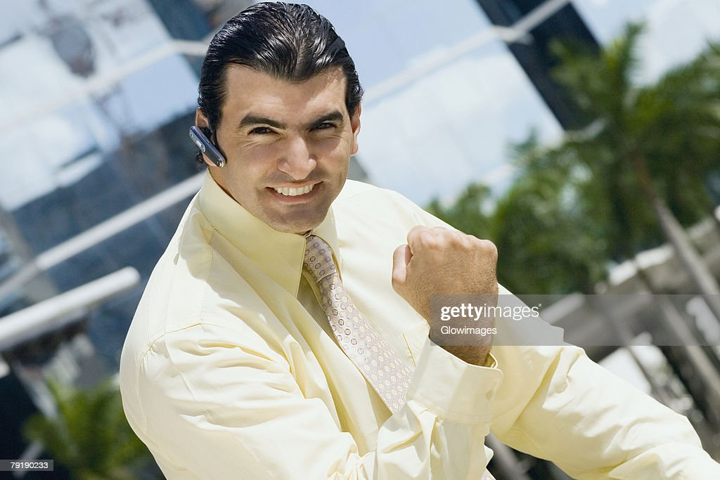 Portrait of a businessman making a fist and looking excited : Stock Photo