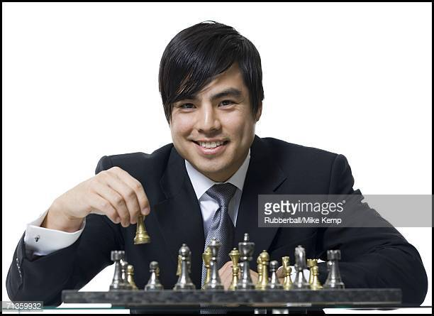 Portrait of a businessman playing chess