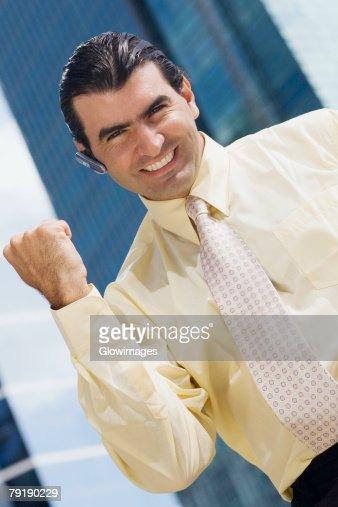 Portrait of a businessman raising his fist and smiling : Foto de stock