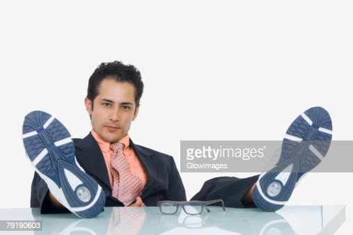 Portrait of a businessman resting with his feet up in an office : Foto de stock