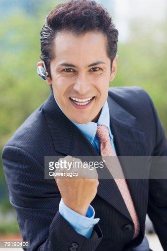 Portrait of a businessman showing his fist and smiling : Foto de stock