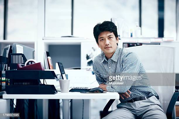 Portrait of a businessman sitting at a desk