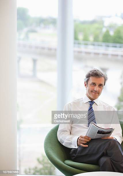 Portrait of a businessman sitting in office cafeteria