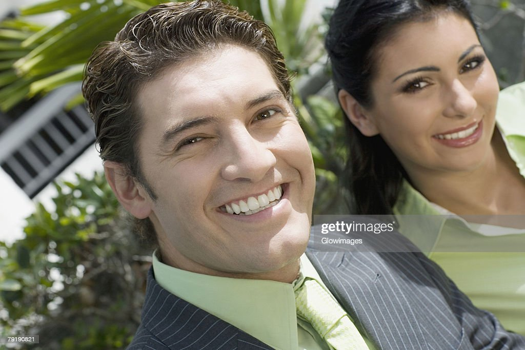 Portrait of a businessman smiling with a businesswoman : Stock Photo