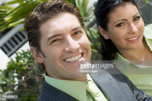 Portrait of a businessman smiling with a businesswoman : Foto de stock