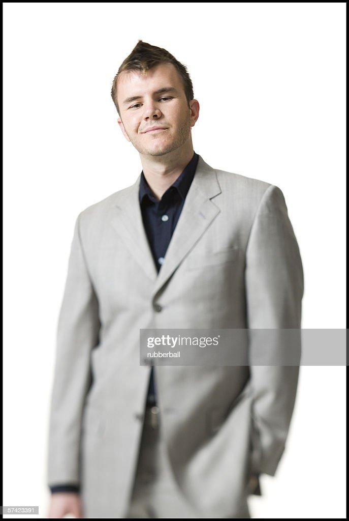 Portrait of a businessman standing : Stock Photo