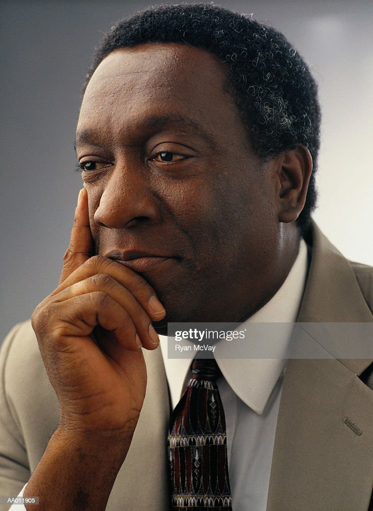 Portrait of a Businessman Thinking : Stock Photo