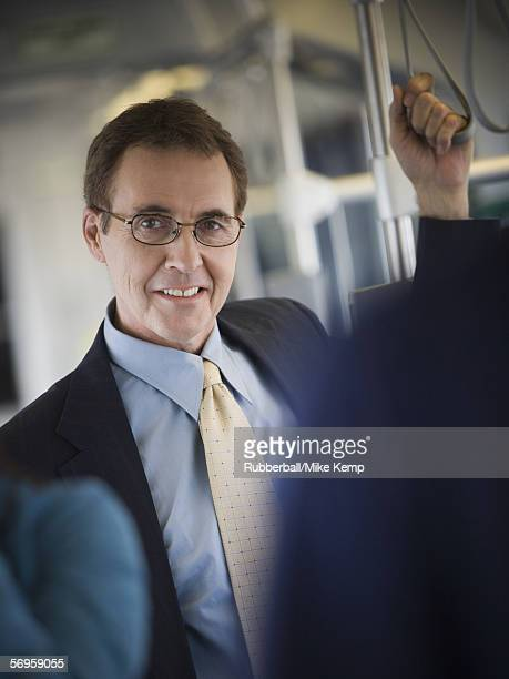 Portrait of a businessman traveling by train