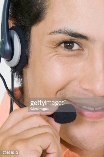 Portrait of a businessman wearing a headset and smiling : Stock Photo