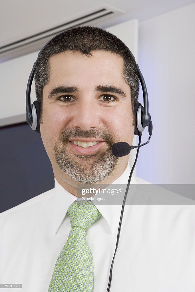 Portrait of a businessman wearing a headset and smiling : Foto de stock