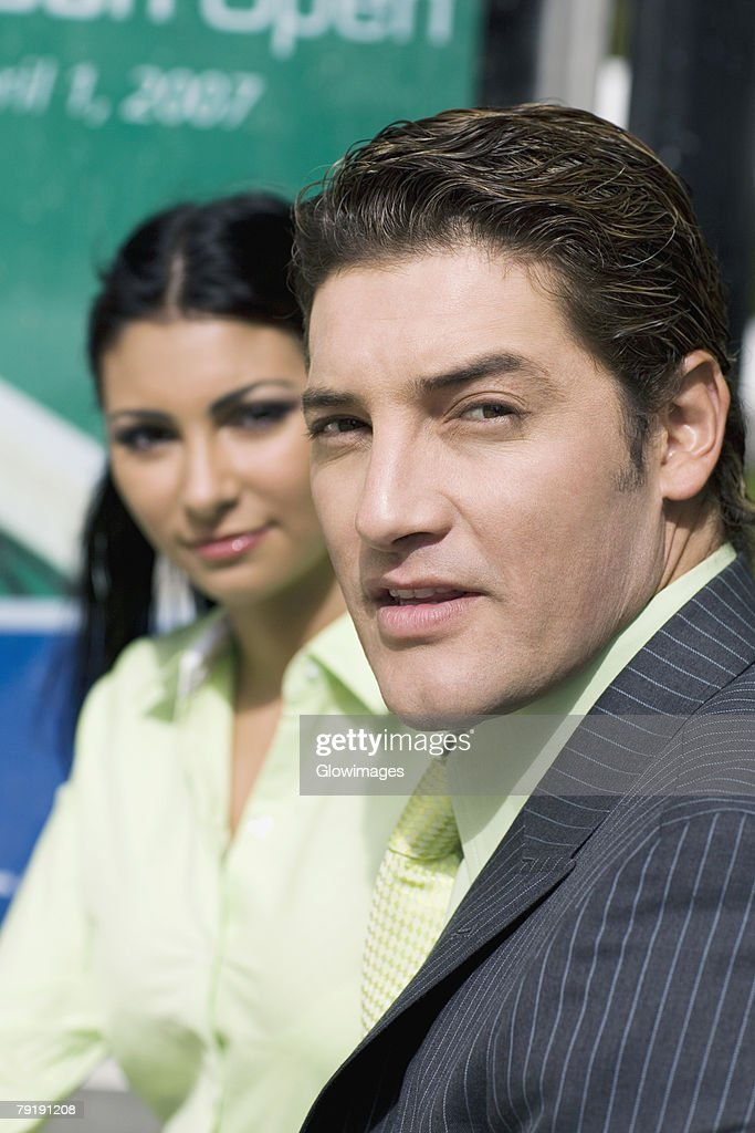 Portrait of a businessman with a businesswoman beside him : Foto de stock