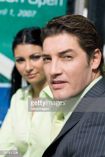 Portrait of a businessman with a businesswoman beside him : Foto de stock
