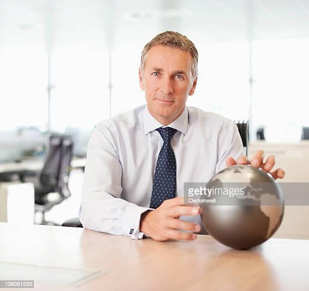 Portrait of a businessman with a globe