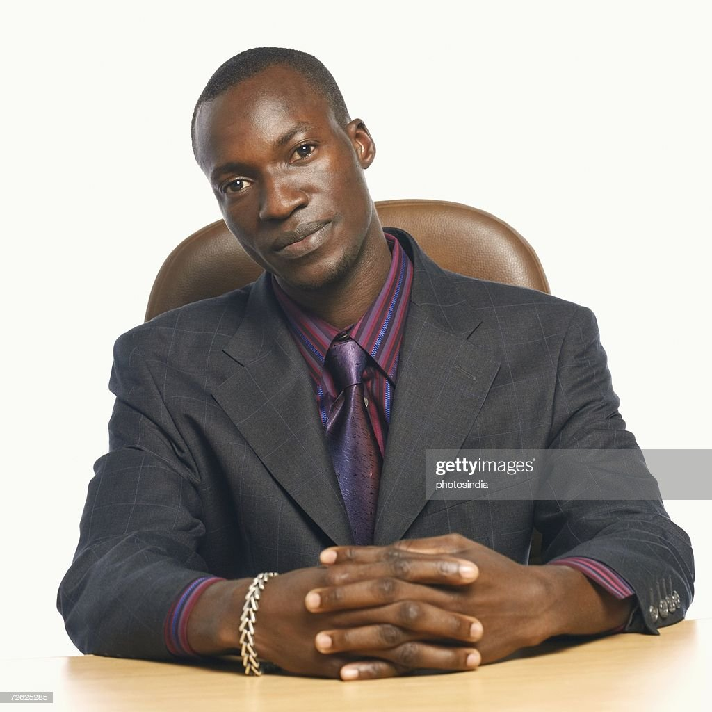 Portrait of a businessman with his hands clasped : Stock Photo