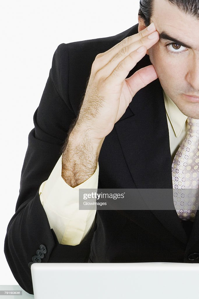 Portrait of a businessman with his head in his hands thinking : Foto de stock