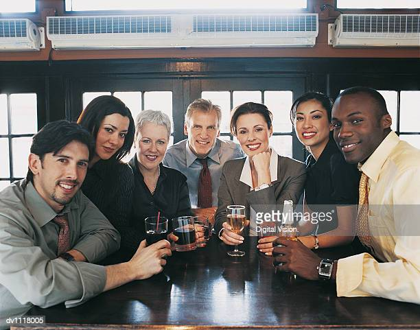 Portrait of a Businessmen and Businesswomen Work Colleagues Enjoying a Drink in a Bar