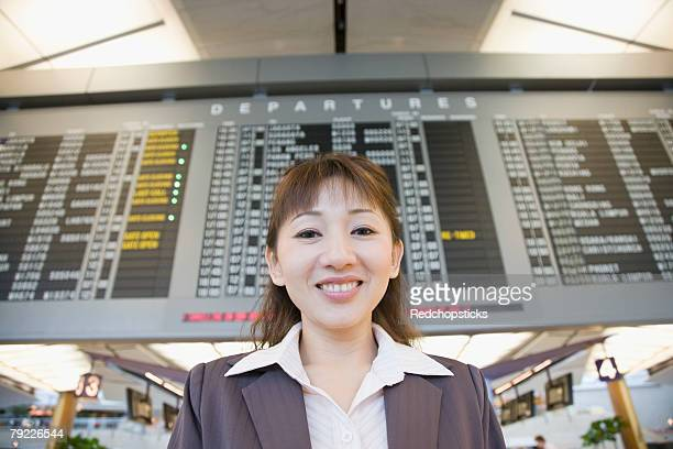 Portrait of a businesswoman at an airport and smiling